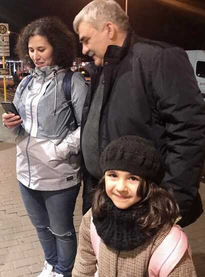 Azerbaijani journalist Afgan Mukhtarli reunites with his wife and daughter at the Berlin airport, March 17, 2020. (Photo courtesy of @ECPMF)