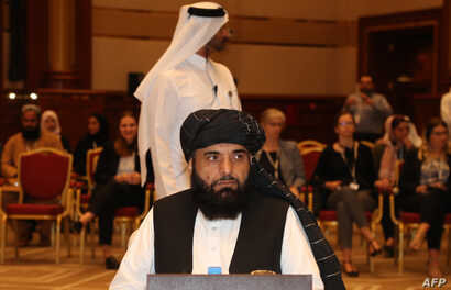 FILE - Taliban spokesman Suhail Shaheen is seen during talks in the Qatari capital Doha, July 7, 2019.
