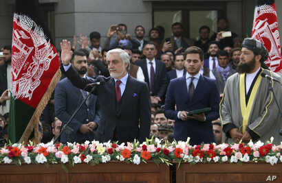 Afghanistan's Abdullah Abdullah, front left, greets supporters after being sworn in as president in an inauguration competing with that of President Ashraf Ghani, in Kabul, Afghanistan, March 9, 2020.