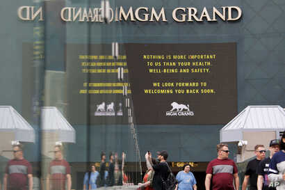 The MGM Grand hotel-casino, which is closing, flashes messages on their marquees, March 16, 2020, in Las Vegas, Nevada.