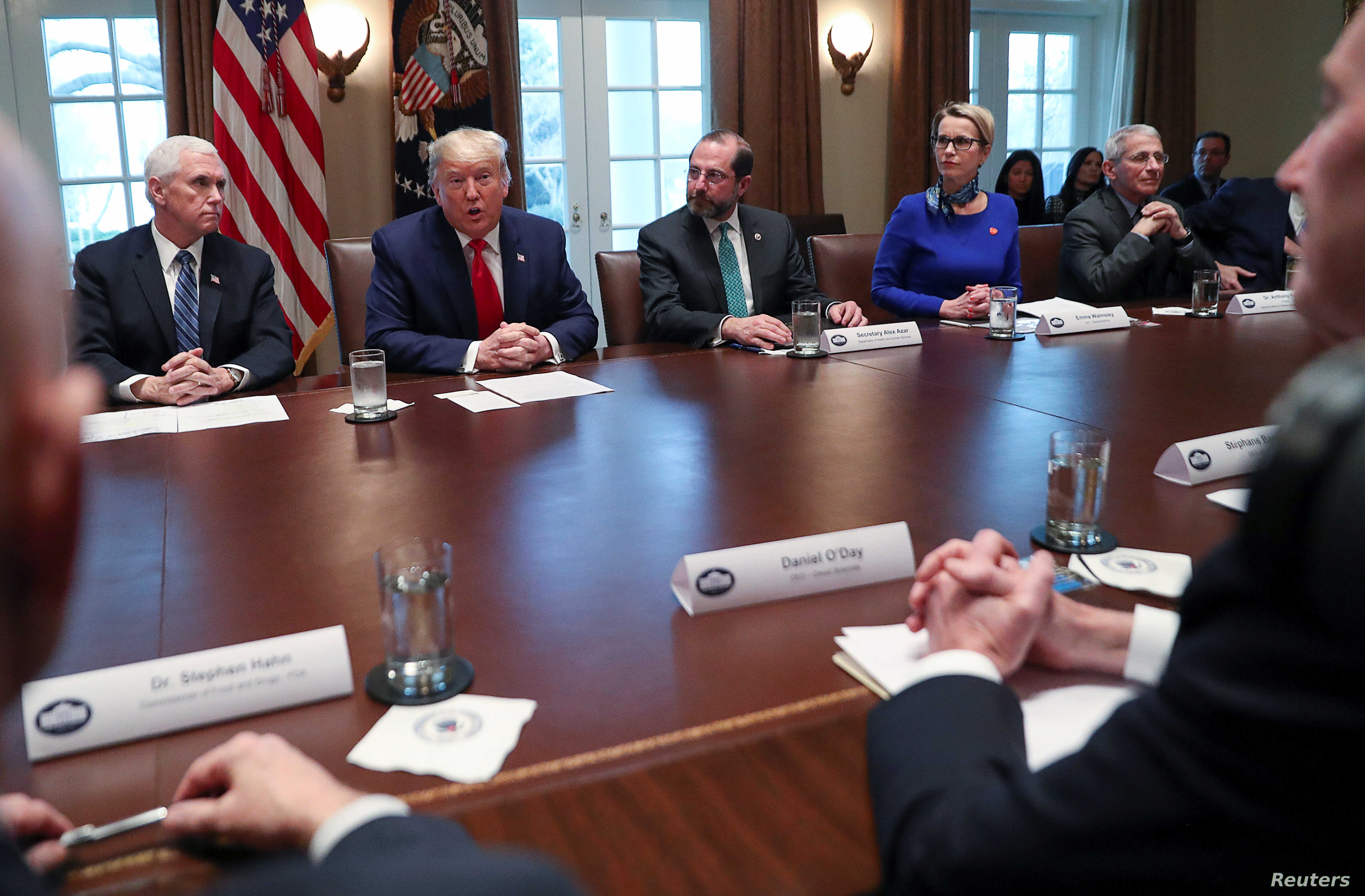 U.S. President Donald Trump, Vice President Mike Pence and Health, Human Services Secretary Alex Azar and members of the coronavirus task force meet with pharmaceutical executives in the Cabinet Room of the White House in Washington, March 2, 2020.