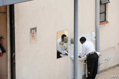 A security guard washed her hands at a Government designated quarantine facility in Nairobi on March 31, 2020. - Hundreds of…