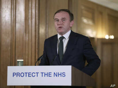Britain's Secretary of State for the Environment George Eustice speaks during a Coronavirus press conference at Downing Street,…