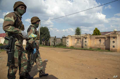 Soldier patrol the streets of Soweto, South Africa, Thursday, April 23, 2020, as the country remains in lockdown for a fourth…