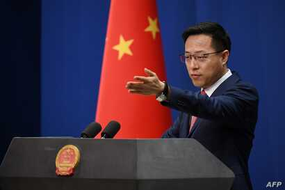 Chinese Foreign Ministry spokesman Zhao Lijian takes a question at the daily media briefing in Beijing on April 8, 2020. (Photo…