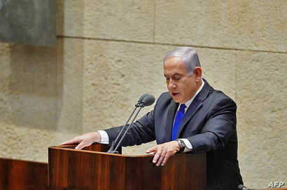 A handout picture provided by the Israeli Knesset spokesperson office shows Israeli Prime Minister Benjamin Netanyahu speaking…