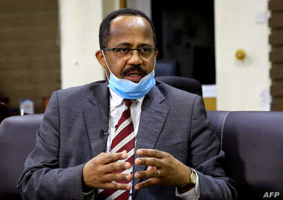 FILE PHOTO: Sudan's Minister of Health Akram Ali Altom speaks during a Reuters interview amid concerns about the spread of…