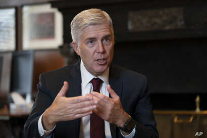 FILE - In this Sept. 4, 2019 file photo, Justice Neil Gorsuch, speaks during an interview in his chambers at the Supreme Court…