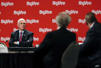 Vice President Mike Pence listens to a speaker during a roundtable with agriculture and food supply leaders about steps being…