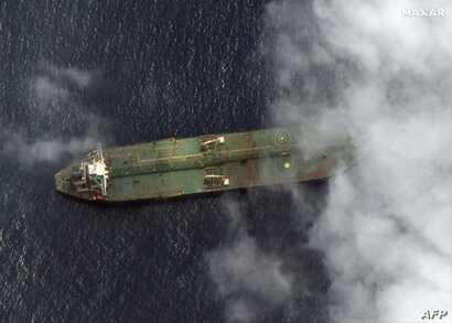 This handout image obtained September 7, 2019, courtesy of Satellite image ©2019 Maxar Technologies, reportedly shows the oil tanker Adrian Darya 1, near the port city of Tartus, Syria, on September 6, 2019. The US on September 6 blacklisted the…
