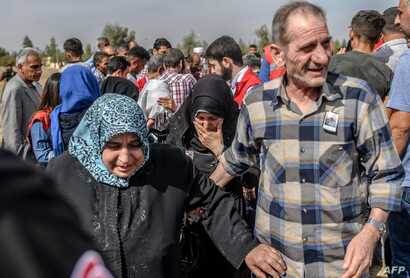 Syrian refugees and relatives of nine-month-old baby, Mohammed Omar, killed in a mortar attack a day earlier in Akcakale near…