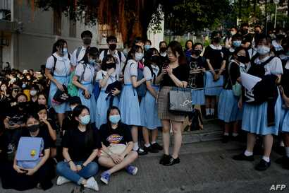 Schoolmates and protesters gather in support of form five student Tsang Chi-kin, 18, who was shot in the chest by police during violent pro-democracy protests that coincided with China's October 1 National Day, during a protest at a school in Hong…