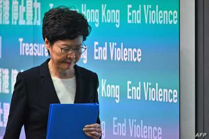 Hong Kong Chief Executive Carrie Lam leaves after a press conference in Hong Kong on October 4, 2019. - Hong Kong's leader on…