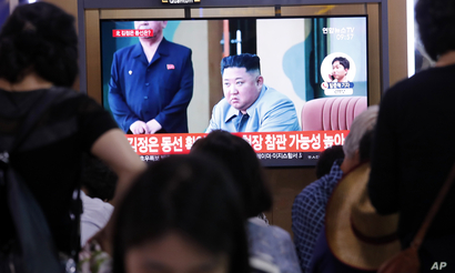 People watch a TV showing a file image of North Korean leader Kim Jong Un during a news program at the Seoul Railway Station in Seoul, South Korea, Wednesday, July 31, 2019. North Korea fired two short-range ballistic missiles off its east coast…