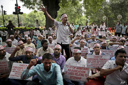 Activists shout slogans during a protest in front of Assam House against the final draft of the National Register of Citizens (NRC) in the northeastern state of Assam, in New Delhi, India, Saturday, Aug. 4, 2018. India on Monday released a final…