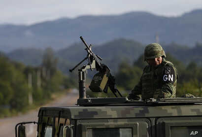 A soldier forming part of the National Guard mans an immigration checkpoint heading north out of Comitan, Chiapas state, Mexico, Sunday, June 16, 2019. Mexican President Andrés Manuel López Obrador said Saturday his country must help Central…