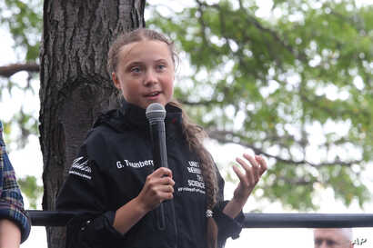 Greta Thunberg, a 16-year-old Swedish climate activist, speaks in front of a crowd of people after sailing in New York harbor aboard the Malizia II, Wednesday, Aug. 28, 2019. The zero-emissions yacht left Plymouth, England on Aug. 14. She is…