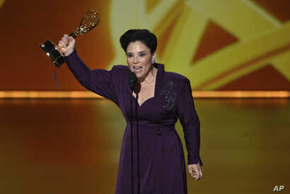 """Alex Borstein accepts the award for outstanding supporting actress in a comedy series for """"The Marvelous Mrs. Maisel"""" at the 71st Primetime Emmy Awards on Sunday, Sept. 22, 2019, at the Microsoft Theater in Los Angeles. (Photo by Chris Pizzello…"""