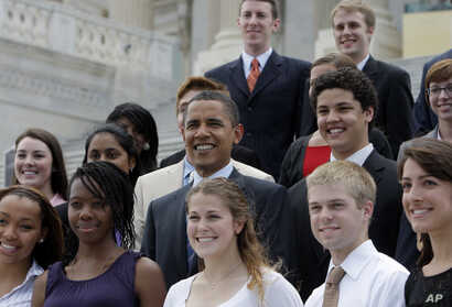 Democratic presidential candidate Sen. Barack Obama, D-Ill., center, poses for photos with Senate interns, Wednesday, July 9, 2008, on Capitol Hill in Washington.