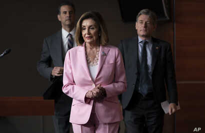 Speaker of the House Nancy Pelosi, D-Calif., joined by Rep. John Sarbanes, D-Md., left, and Rep. Tom Malinowski, D-N.J., leads House Democrats to discuss H.R. 1, The For the People Act, which passed in the House but is being held up in the Senate,…