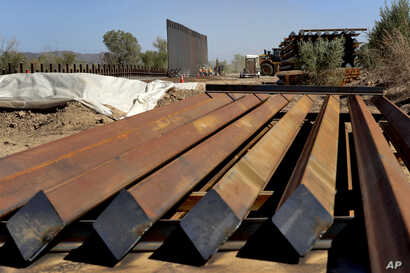Sections of Pentagon-funded border wall are stacked prior to installation along the Colorado River, Tuesday, Sept. 10, 2019 in Yuma, Ariz. A 30-foot high wall will replace a five-mile section of Normandy barrier and post-n-beam fencing along the the…