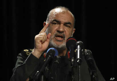 Chief of Iran's Revolutionary Guard Gen. Hossein Salami speaks in a ceremony displaying pieces of the American drone shot down by the Guard in the Strait of Hormuz in June, in Tehran, Iran, Saturday, Sept. 21, 2019. Salami said his forces are ready…