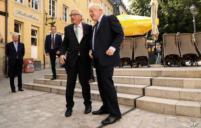 European Commission President Jean-Claude Juncker, left, shakes hands with British Prime Minister Boris Johnson prior to a meeting at a restaurant in Luxembourg, Monday, Sept. 16, 2019. British Prime Minister Boris Johnson was holding his first…