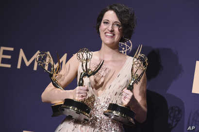 """Phoebe Waller-Bridge, winner of the awards for outstanding lead actress in a comedy series, outstanding comedy series and outstanding writing for a comedy series for """"Fleabag,"""" poses in the press room at the 71st Primetime Emmy Awards on Sunday,…"""