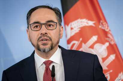 Foreign minister of Afghanistan Salahuddin Rabbani talks to the media at a press conference in Berlin, Germany, Friday, June 28, 2019. (Kay Nietfeld/dpa via AP)