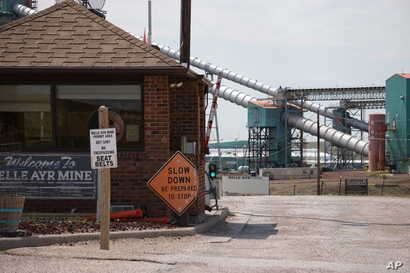 In this Thursday, Sept. 5, 2019 photo shows the entrance to the Blue Ayr Mine south of Gillett, Wyo. The shutdown of Blackjewel LLC's Belle Ayr and Eagle Butte mines in Wyoming since July 1,2019, has added yet more uncertainty to the Powder River…
