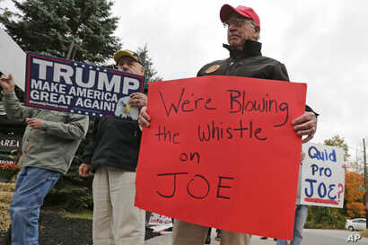 Supporters of President Donald Trump picket outside an event for Democratic presidential candidate former Vice President Joe…