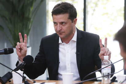 Ukrainian President Volodymyr Zelenskiy speaks during talks with journalists in Kyiv, Ukraine, Thursday, Oct. 10, 2019…
