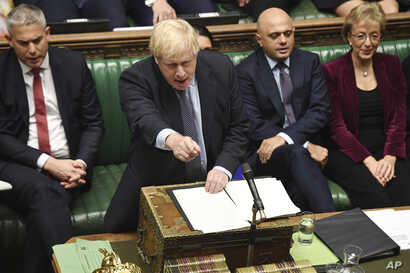 Britain's Prime Minister Boris Johnson speaks to lawmakers inside the House of Commons