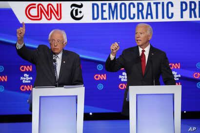 Democratic presidential candidate Sen. Bernie Sanders, I-Vt., left, and former Vice President Joe Biden participate in a…