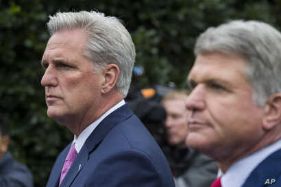 House Minority Leader Kevin McCarthy of Calif., left, and Rep. Michael McCaul, R-Texas, speak with reporters after a meeting…