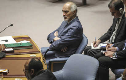 Syria's United Nations Ambassador Bashar Jaafari listen during a U.N. Security Council's meeting on Syria, Thursday Sept. 19,…