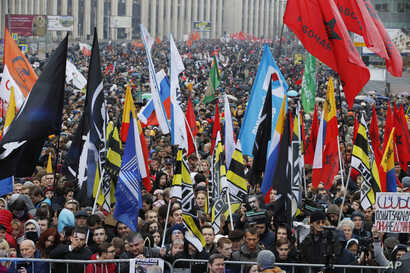 People hold various banners and flags during a rally to support political prisoners in Moscow, Russia, Sunday, Sept. 29, 2019. …