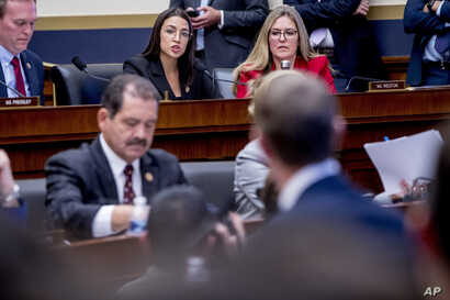 Rep. Alexandria Ocasio-Cortez, D-N.Y., top center, questions Facebook CEO Mark Zuckerberg, foreground, as he appears before a…