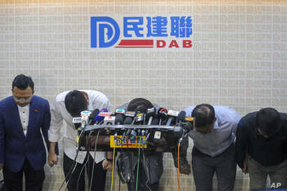 Candidates from pro-Beijing political party bow to apologize for their defeat in the local district council election in Hong…