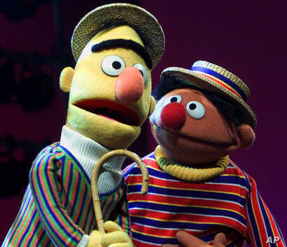 FILE - In this Aug. 22, 2001 file photo, original muppet characters Bert, left, and Ernie, from the children's program