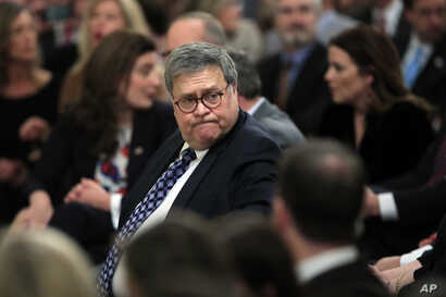 Attorney General William Barr arrives before President Donald Trump speaks in the East Room of the White House about his…