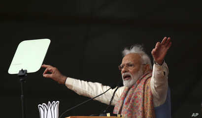 Indian Prime Minister Narendra Modi addresses a rally of his Hindu nationalist Bharatiya Janata Party in New Delhi, India,…