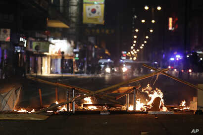 Debris burns on a street during a rally in Hong Kong, Wednesday, Dec. 25, 2019. More than six months of protests have beset the…