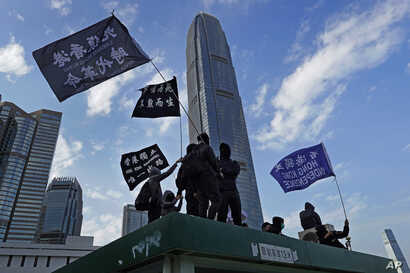 """Protesters wave flags that read """"Hong Kong Independence"""" during a rally in Hong Kong, Sunday, Jan. 12, 2020. More than a…"""