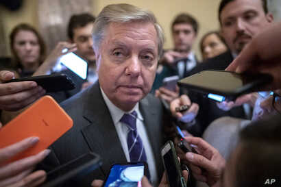 Senate Judiciary Committee Chairman Lindsey Graham, R-S.C., is surrounded by reporters after he and Republican lawmakers met…