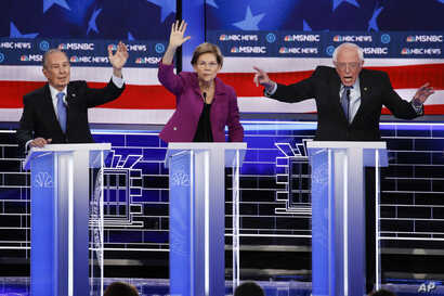 From left, Democratic presidential candidates, former New York City Mayor Mike Bloomberg, Sen. Elizabeth Warren, D-Mass., Sen…