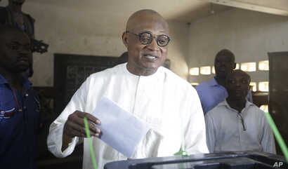 Jean-Pierre Fabre, opposition presidential candidate of the National Alliance for Change, casting his vote during the…