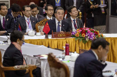 China's Foreign Minister Wang Yi, center back, attends the Special ASEAN-China Foreign Ministers' meeting on the Novel…