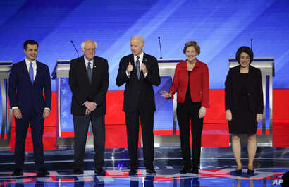 From left, Democratic presidential candidates Pete Buttigieg, Sen. Bernie Sanders, Joe Biden, Elizabeth Warren, and Amy Klobuchar, are seen ahead of their primary debate at Saint Anselm College in Manchester, New Hampshire, Feb. 7, 2020.