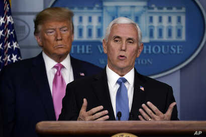 President Donald Trump listens as Vice President Mike Pence speaks during a news conference about coronavirus in the Brady…